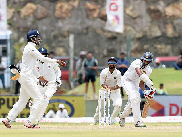 Indian cricket team captain Virat Kohli (L) and teammate Shikhar Dhawan speak after defeat on the fourth day of the opening Test match between Sri Lanka and India at the Galle International Cricket Stadium in Galle. (AFP Photo)