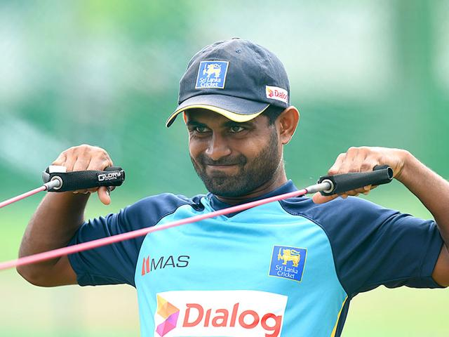 Sri Lankan cricket opener Kaushal Silva stretches during a practice session on the eve of the first Test against India in Galle, starting on August 12. (AFP Photo)