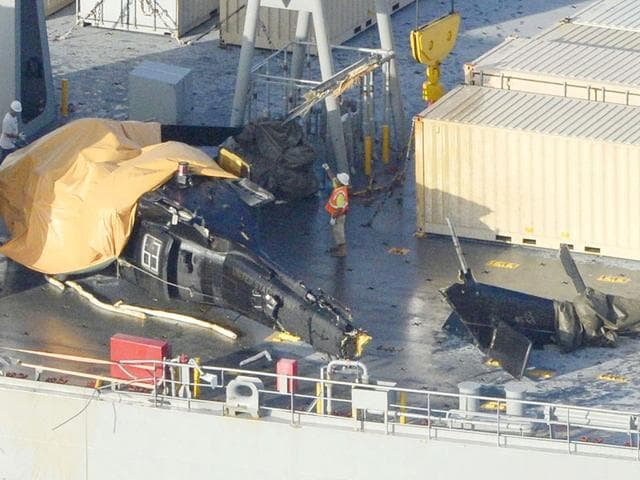 A damaged US Army helicopter rests on the desk of the USNS Red Cloud off Okinawa island, southern Japan. The helicopter crashed in waters off the Japanese southern island of Okinawa during a training mission on Wednesday. (Reuters/Kyodo)