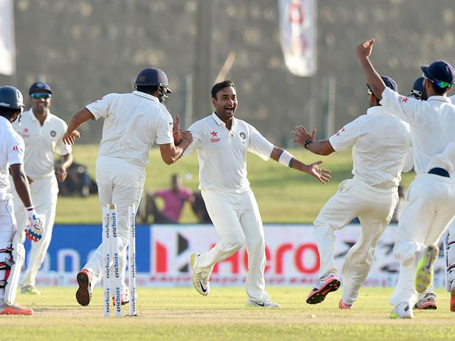 Indian cricketer Amit Mishra (C) and teammates celebrate after dismissing Sri Lankan batsman Kaushal Silva (L) during the second day of the opening Test match between Sri Lanka and India at The Galle International Cricket Stadium in Galle. AFP PHOTO/ Ishara S. KODIKARA