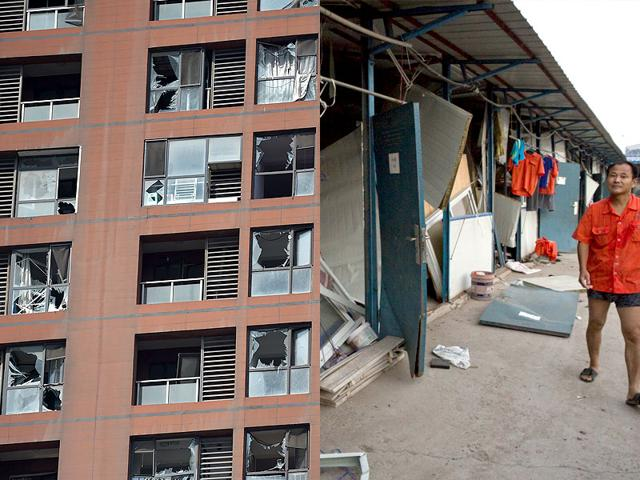 Alongside pristine new buildings that epitomise China's rise sat twisted metal, torn off roofs and burnt out huts (Photo: AFP/AP)