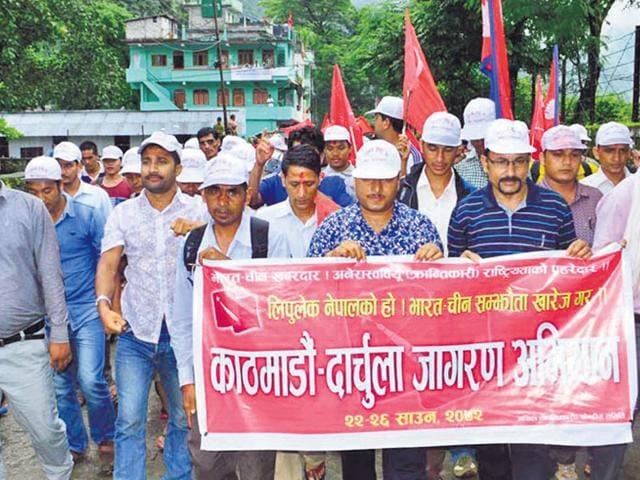 Akhil Nepal Krantikari Sangthan members hold a demonstration at Darchula in Nepal. (HT photo)