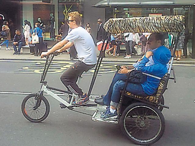 Rickshaws plying on London's Oxford Street. (HT Photo)