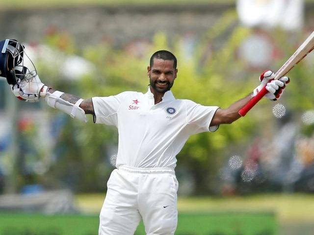 India's Shikhar Dhawan celebrates his century during the second day of their first test cricket match against Sri Lanka in Galle,. REUTERS/Dinuka Liyanawatte