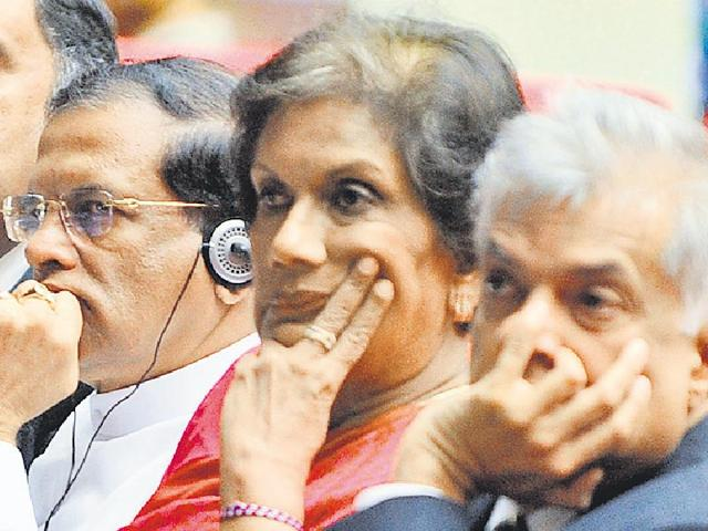 Sirisena (second from left) has restored some powers to the prime minister. (AFP Photo)