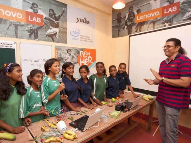 YUWA girls playing songs with the help of Makey-Makey kits while musician Surojit Chatterjee watches on. (Picture credit: Pitchtoher.com)