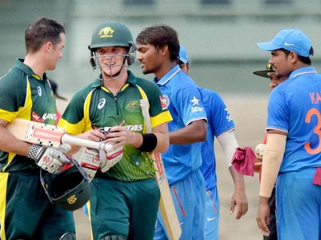 Australia A players Adam Zampa and Callum Ferguson shake hands with their India A counterparts after the match at the MA Chidmabaram Stadium in Chennai on August 10, 2015. India A beat Australia A in the tri-series final on August 14. (PTI Photo)