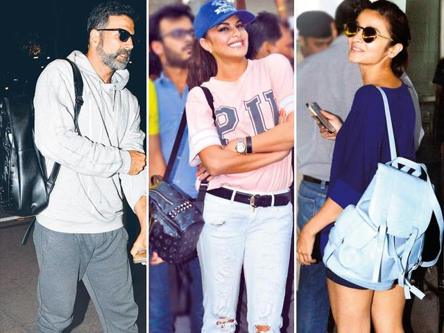 It's time to head back to school and make backpacks a part of your playful street style. From actors Alia Bhatt to Akshay Kumar, fashion forward celebs have been spotted rocking chic rucksacks.(HT Photo)