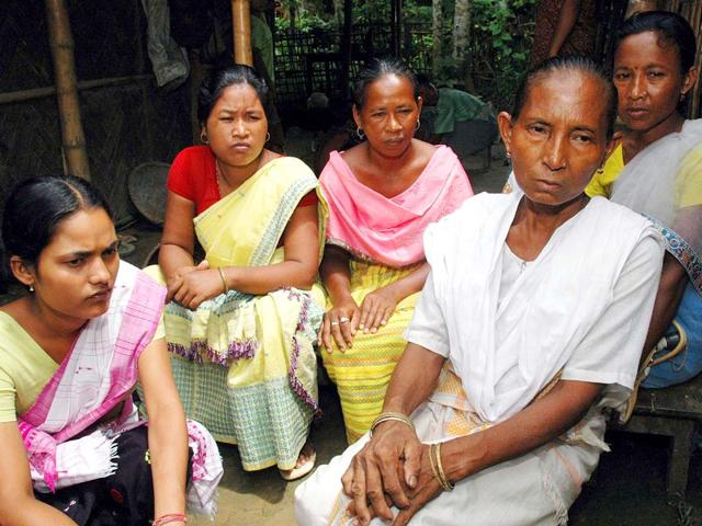 Birubala Rabha (in white dress) has been crusading against witch-hunting after a village quack almost killed her son in 1996. (Subhamoy Bhattacharjee/HT Photo)