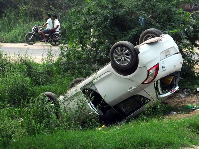 The car which got into an accident opposite lehara mahobat tharmal plant at Bathinda on Fariday. (HT Photo)