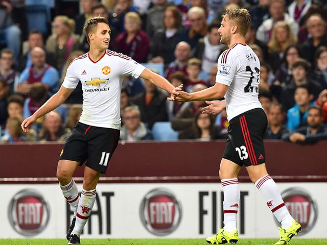 Manchester United's Adnan Januzaj (L) celebrates with teammate Luke Shaw after scoring a goal during the English Premier League (EPL) match between Aston Villa and Manchester United at Villa Park in Birmingham, England on August 14, 2015. (AFP Photo)