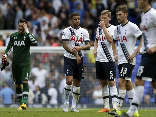 Tottenham players look dejected following the EPL football match between Tottenham Hotspur and Stoke City at White Hart Lane. (AP Photo)