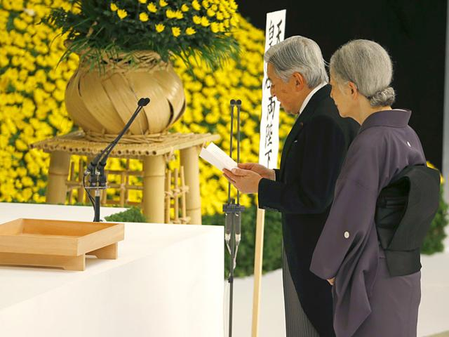 Japan's Emperor Akihito, right, delivers his remarks with Empress Michiko during a memorial service at Nippon Budokan martial arts hall in Tokyo (AP Photo)