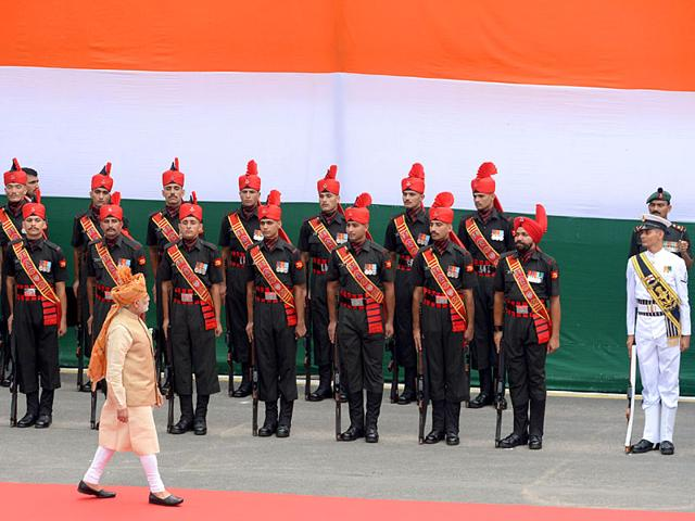 Prime Minister Narendra Modi inspects an honour guard of troops after delivering his speech. In his speech, Modi insisted that he would eradicate corruption in India but warned the problem started at the top and was eating away at the country