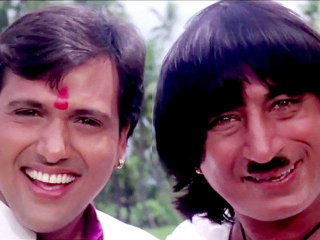 Govinda and Shakti Kapoor in a still from David Dhawan's Raja Babu.