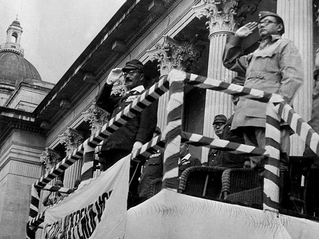 Subhash Chandra Bose with Japanese Prime Minister Hideki Tojo at a parade for Indian national independence at Shonan, Japan in 1944. (Getty Images)