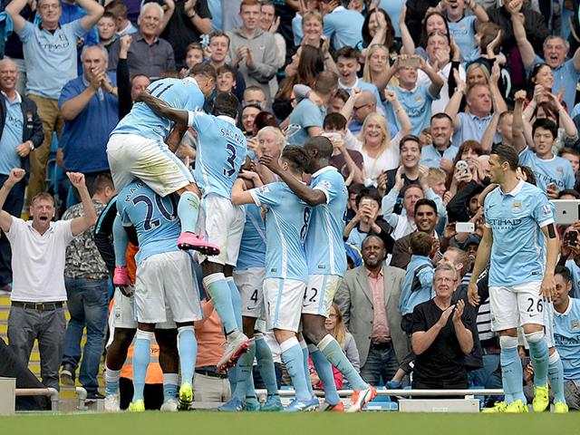 Manchester City celebrates scoring their second goal during the English Premier League football match with Chelsea at The Etihad stadium in Manchester, north west England on August 16, 2015. Manchester City won the game 3-0. (AFP PHOTO)
