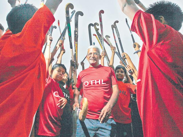 K Arumugam (centre), who quit his job as a scientist with the central government to promote the sport, is neither a hockey player nor a coach himself. He hires professional trainers. The 58-year-old can often be seen at schools, cheering his hockey teams. (Raj K Rak/ HT Photo)