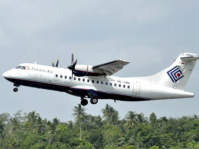 In this photo taken Dec. 26, 2010, Trigana Air Service's ATR42-300 twin turboprop plane takes off at Supadio airport in Pontianak, West Kalimantan, Indonesia. The same type of a Trigana airliner carrying 54 people was missing Sunday, Aug. 16, 2015 after losing contact with ground control during a short flight in bad weather in the country's mountainous easternmost province of Papua, officials said. (AP Photo)