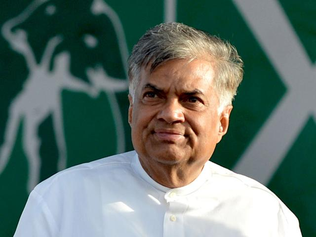 Sri Lankan Prime Minister Ranil Wickremesinghe looks on during a rally in Galle during his campaign for the Sri Lankan parliamentary elections scheduled on August 17. (AFP photo/Ishara S Kodikara)