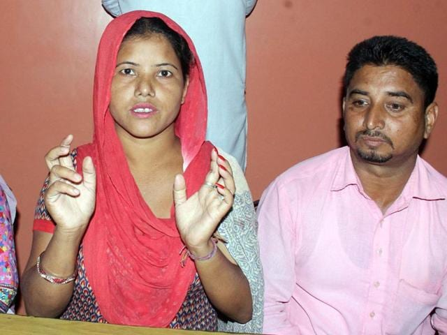 Manpreet Kaur seeking action against the village sarpanch and others while talking to the media in Moga on Sunday. (HT Photo)