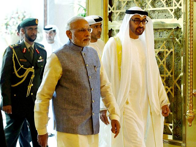 Prime Minister Narendra Modi with the Crown Prince of Abu Dhabi Sheikh Mohammed Bin Zayed al Nahyan on his arrival in Abu Dhabi on Sunday. (PTI Photo)