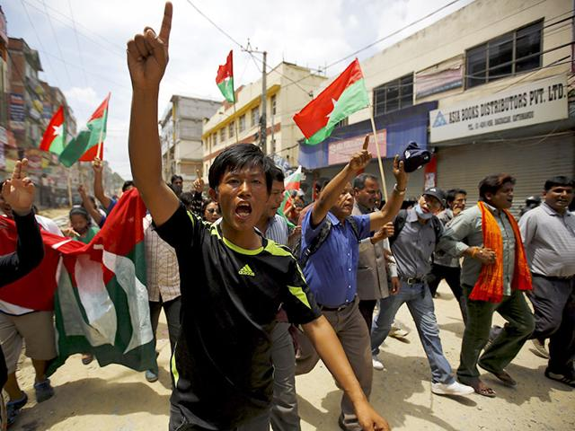 Protesters chant slogans as they march on a road during a general strike organised by a 30-party alliance led by a hardline faction of former Maoist rebels, who are protesting against the draft of the new constitution, in Kathmandu. (Reuters Photo)