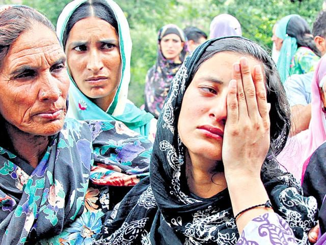 The daughter of a sarpanch who was killed in Pakistani shelling is consoled by relatives in a Jammu village on Sunday.(AP Photo)