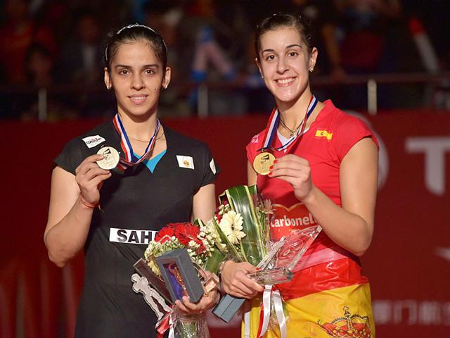 Saina Nehwal returns a shot to Spain's Carolina Marin during their women's singles badminton final at the BWF World Championships in Jakarta, Indonesia on August 16, 2015. (Reuters Photo)