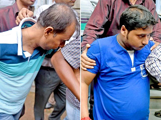Pranab Adhikari(L), sub-assistant engineer of Bally Municipality and his son Tanmoy Adhikari being produced in a court in Kolkata after ACB recovered Rs 20 crore and gold ornaments from their residence in Howrah district in West Bengal. (PTI Photo)