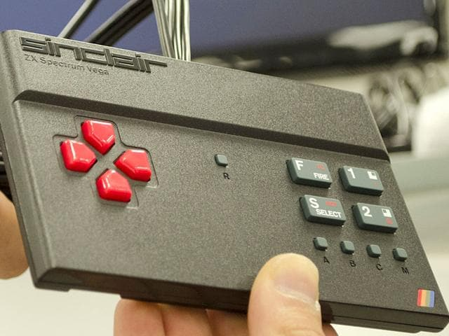 A technician holds up a new ZX spectrum console at the factory in Nottingham on. (AFP Photo)