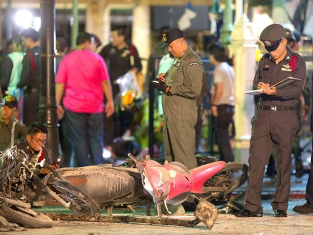 Police investigate the scene after the explosion in Bangkok (AP Photo)