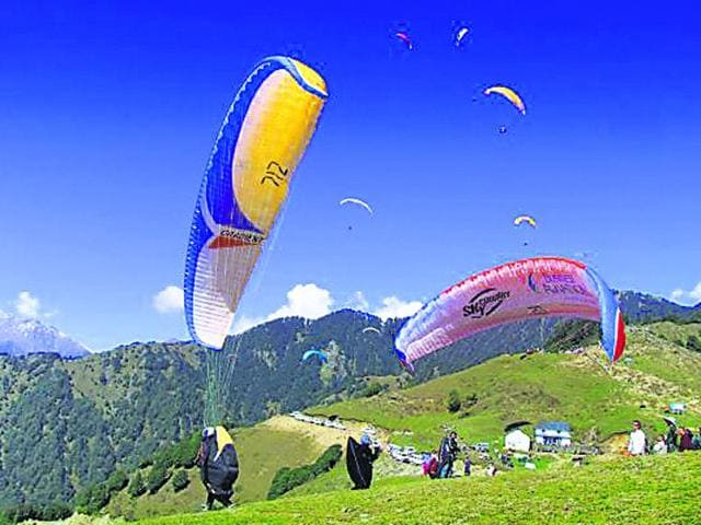 Adventure sport lovers fly over skies of Bir Billing in Himachal, one of the best paragliding site in the world.