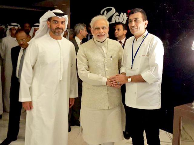 Chef Sanjeev Kapoor with Prime Minister Narendra Modi in UAE. Sanjeev Kapoor was flown in to cook a grand vegetarian feast for the Prime Minister. (Photo courtesy: @SanjeevKapoor)