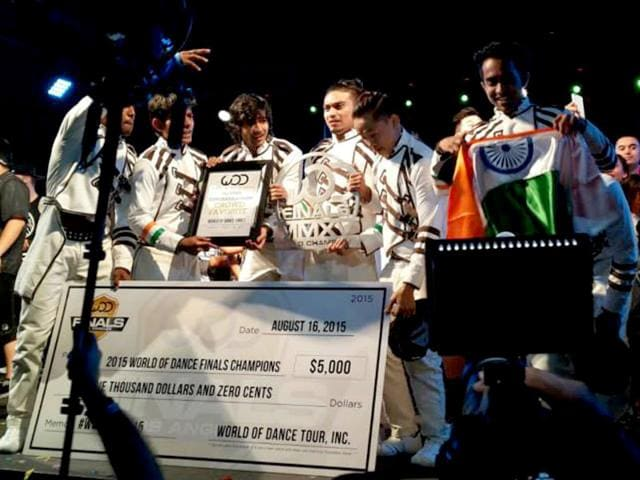 Desi Hoppers with their cheque after winning the World of Dance championship.