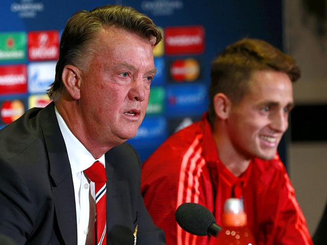 Manchester United manager Louis van Gaal and Belgian player Adnan Januzaj during a press conference ahead of United's Champions League play-off round match against Belgian side Club Brugge at Old Trafford on August 18, 2015. (Reuters Photo)