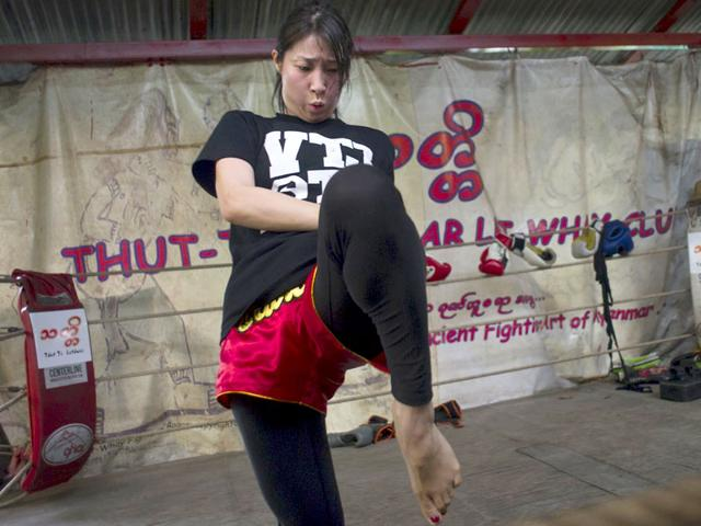 A young woman practices Myanmar's homespun martial art Lethwei -- a sport that encourages head-butting and grants victory by knock-out only -- at a gym in Yangon. (AFP Photo)