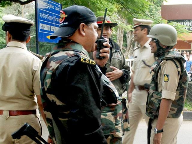A special team of the anti-terror Garuda force with police personal were seen taking positings outside one of the buildings of Nimhans in Bengaluru. A mentally unstable under trial, Vishwanath, had snatched a rifle from a guard and fired 23 rounds. He died from bullet injuries sustained during the incident (PTI Photo)