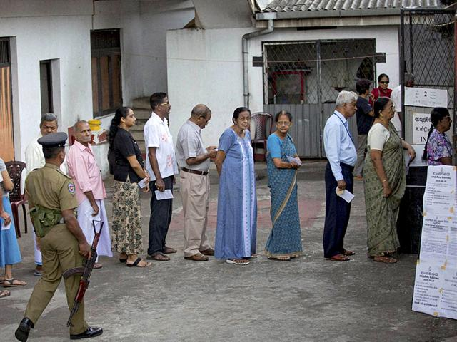 Sri Lankan voters queue to cast their vote at a polling center in Colombo, Sri Lanka. (AP/PTI photo)
