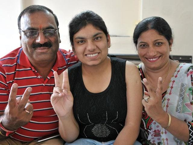 Akshita Gupta, who achieved the third highest rank in the tricity in the AIPMT test, in a jubilant mood with her parents at her house in Sector 30, Chandigarh, on Monday. (Keshav Singh/HT)
