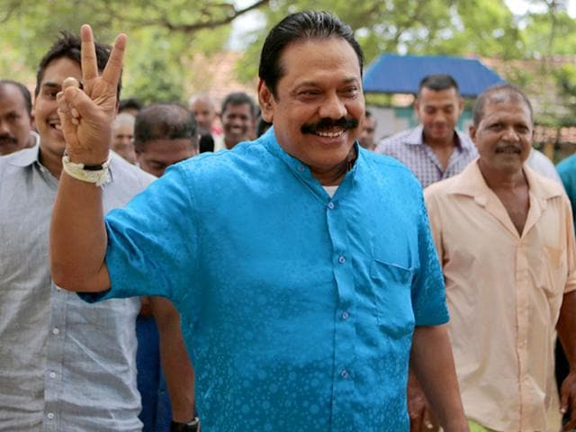 Parliamentary candidate Mahinda Rajapaksa makes the victory sign after casting his vote in Medamulana village, southern Sri Lanka, Monday, Aug. 17, 2015 (AP Photo)