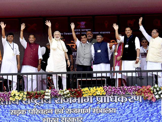 Prime Minister Narendra Modi with Union Ministers Nitin Gadkari, Radha Mohan Singh, Ravishankar Prasad, Rajiv Pratap Rudy and others during laying of the foundation stone of four-lane Patna-Buxar road and a bridge parallel to the Abdul Bari bridge over river Sone at Koilwar near Arrah on Tuesday. Assembly elections are due in Bihar later this year and the PM has been addressing election rallies in the state. (PTI Photo)