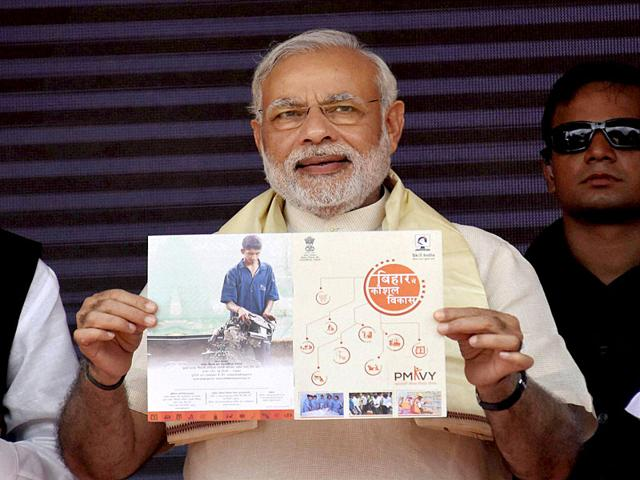 Prime Minister Narendra Modi releasing a brochure at the inauguration of the Skill Training Centers in Arrah, Bihar on Tuesday. (PTI Photo)