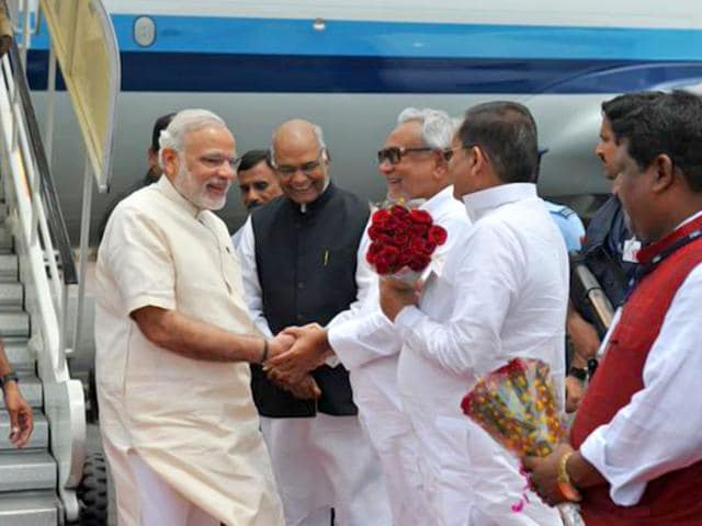 Prime Minister Narendra Modi greeted by Bihar chief minister Nitish Kumar. Modi said the central government was formulating special schemes to empower women and OBCs in the state of Bihar. (Image via Twitter, @PIB_India)