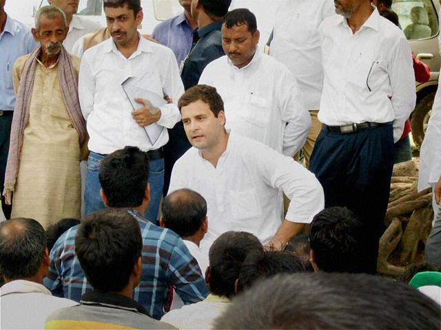 Congress Vice President Rahul Gandhi interacts with people in Shukul Bazar during his visit to Amethi on August 18, 2015. (PTI Photo)