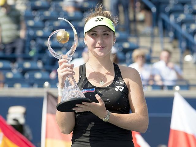 Belinda Bencic of Switzerland holds up the Rogers Cup trophy after winning the final against Simona Halep of Romania at the Aviva Centre in Toronto, on August 16, 2015. Bencic won 7-6, 6-7, 3-0 after Halep retired in the third set. (Reuters Photo)