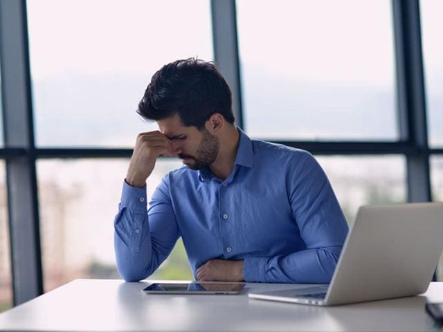 According to a study, symptoms of depression were reported by 18% of supervisors and managers compared to 12% for workers. (Shutterstock photo)