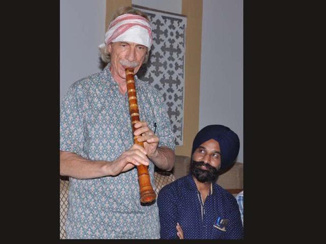International music expert Tim Hoffman playing Shakuhachi at a press meet in Karnal. CL Kashyap/HT