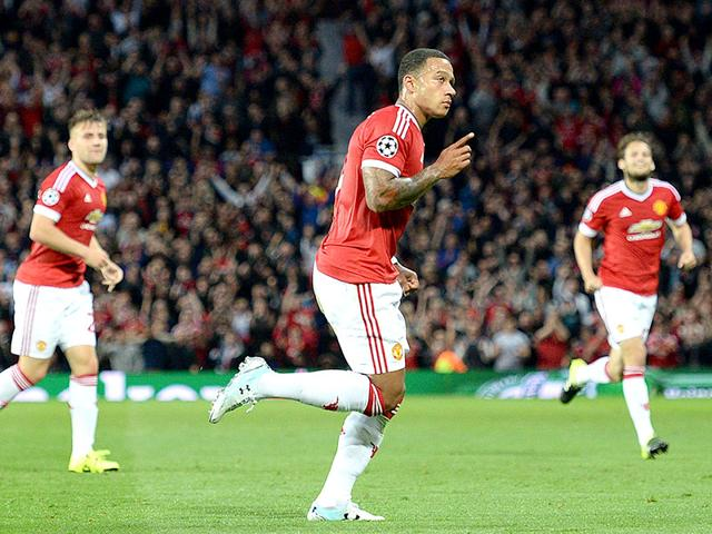 Manchester United's Dutch midfielder Memphis Depay (C) celebrates after scoring his team's second goal during the Uefa Champions League play-off match against Club Brugge at Old Trafford in Manchester, on August 18, 2015. (AFP Photo)