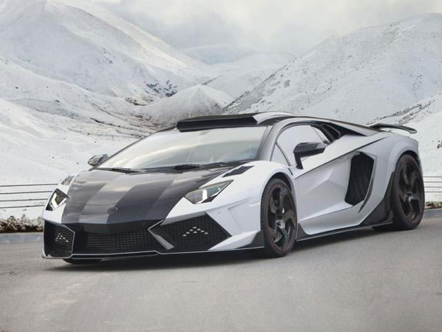 Mansory Carbonado GT - $1.4 million : However, once Mansory is finished with it, the car's performance figures are off the scale. Adding two turbos up the power to 1600hp, cuts the 0-100km/h dash to 2.1 seconds and increases the top sped to 370+km/h. Keeping this extra power in check means that the exterior has been largely reworked in carbon fiber to improve downforce and stability at high speeds. Photo:AFP